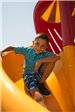 Boy Going Down Slide