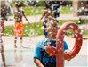 Boy Playing With Splash Pad Feature