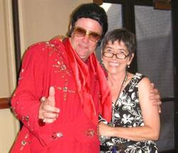 Woman with man dressed as Elvis